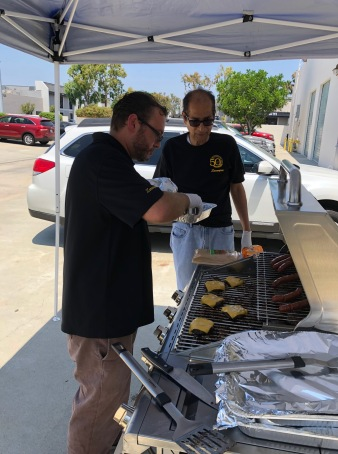 Bob and Josh working the grill.